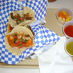 Three tacos: Puerco en Pasilla, Pollo en Pipian, and Pisinan Roast